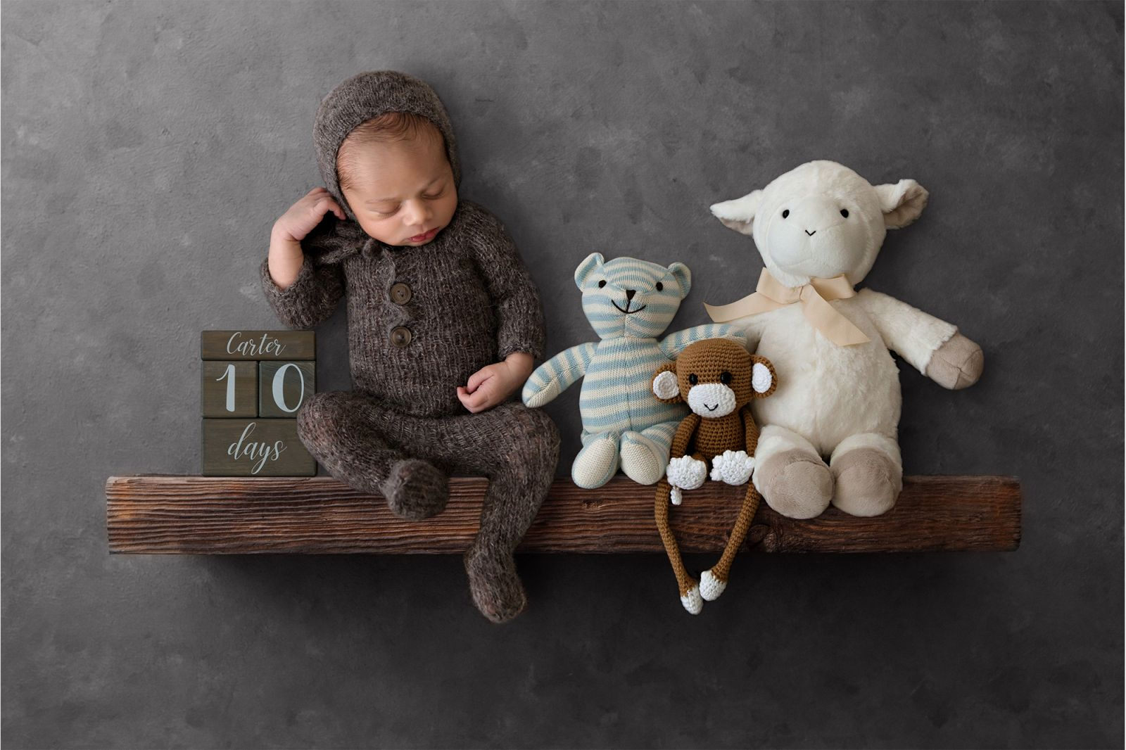newborn composite baby on shelf